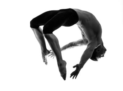 Man portrait gymnastic jumping bend